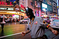 A man disguised as Batman walks the streets of Times Square after NYPD increased security at movie theaters after 'Dark Knight Rises' premier in New York, July 20, 2012.  Photo by Eduardo Munoz Alvarez / VIEW.
