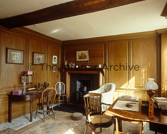 The wood-panelled housekeeper's room at Erddig is  strategically placed between the still-room, the kitchen, the scullery and the servants' hall