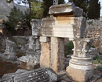 CORINTH, GREECE - APRIL 16 : A detail of Temple C, on April 16, 2007 in Corinth, Greece. Situated next to the Fountain of Glauke, Temple C, built in the 1st century BC or AD, may have been dedicated to Octavia or Hera. This collection of fragments of lintels, Corinthian capitals and columns is seen in the early morning light. Corinth, founded in Neolithic times, was a major Ancient Greek city, until it was razed by the Romans in 146 BC. Rebuilt a century later it was destroyed by an earthquake in Byzantine times. (Photo by Manuel Cohen)