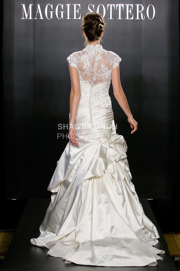 Model walks the runway in a Chantilly wedding dress from the Sottero and Midgley Spring 2012 collection, during  Couture: New York Bridal Fashion Week 2012