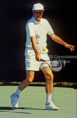 United States President George H.W. Bush plays a game of tennis at his summer vacation home in Kennebunkport, Maine on August 8, 1991..Mandatory Credit: David Valdez / White House via CNP