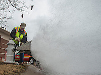 NWA Democrat-Gazette/ANTHONY REYES @NWATONYR<br /> Ken Mitchell, with the Rogers Water Utilities, uses a guage to check the flow rate Tuesday, Feb. 14, 2017 at a fire hydrant at First Street and Maple Street in Rogers. The test measured the flow rate for the hydrant to help plan the water and fire fighting needs for new construction across the road.