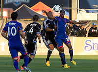 Victor Bernardez of Earthquakes fights for a loose ball against Deshorn Brown of Rapids during the game at Buck Shaw Stadium in Santa Clara, California on May 18th, 2013.  San Jose Earthquakes tied Colorado Rapids, 1-1.