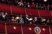 United States President Barack Obama and First Lady Michelle Obama wave at the beginning of a show for the Kennedy Center Honorees at the Kennedy Center, December 4, 2016, Washington, DC. The 2016 honorees are: Argentine pianist Martha Argerich; rock band the Eagles; screen and stage actor Al Pacino; gospel and blues singer Mavis Staples; and musician James Taylor.<br /> Credit: Aude Guerrucci / Pool via CNP