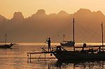 Silhouettes of fishermen at dawn, Komodo Village, Komodo National Park