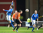 Dundee United v St Johnstone...12.03.14    SPFL<br /> Stevie May gets a shove in the back from John Rankin<br /> Picture by Graeme Hart.<br /> Copyright Perthshire Picture Agency<br /> Tel: 01738 623350  Mobile: 07990 594431