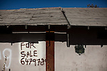 An abandoned home for sale in Mendota, Calif., September 10, 2012.