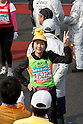 Feb. 28, 2010 - Tokyo, Japan - A runner poses for a picture at the finish line during the 2010 Tokyo Marathon. Despite the cold and rain, more than 30,000 athletes participated in the event.