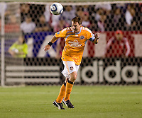 Houston Dynamo midfielder Richard Mulrooney (8) heads a ball. The Houston Dynamo defeated CD Chivas USA 2-0 at Home Depot Center stadium in Carson, California on Saturday May 8, 2010.  .