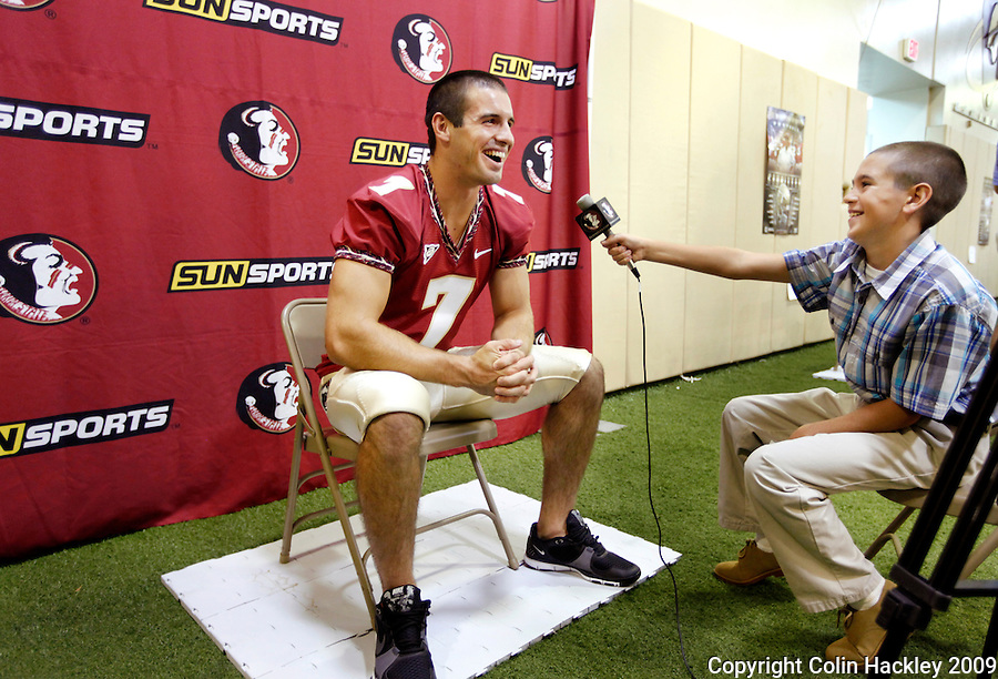 TALLAHASSEE, FL 8/8/10-FSU-080810 CH-Florida State quarterback Christian Ponder talks with Seminoles.com reporter Blaine Thomas, age 13, during media day Sunday in Tallahassee. .COLIN HACKLEY PHOTO
