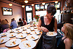 "Beast is a six-course, prix fixe restaurant in NE Portland, Oregon whose menu changes every Wednesday.  Chef Naomi Pomeroy (and single mom) and partner Micah Paredes focus on local ingredients in a style which they call ""refined French grandmother.""  Here Naomi is pictured with her daughter, August."