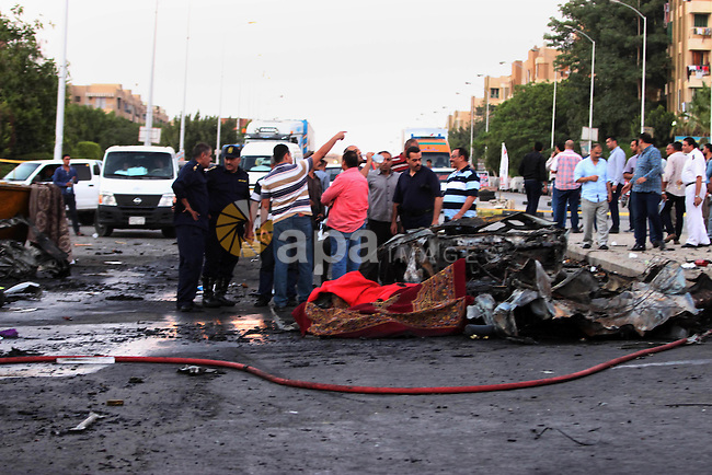 Egypt's security forces investigate the site of an explosion in Six of October district in Cairo, Egypt, Tuesday, June 30, 2015. The blast near a police station occurred hours after President Abdel-Fattah el-Sissi was speaking during the funeral of the country's chief prosecutor, Hisham Barakat, who was killed Monday. Authorities has declared June 30 a national holiday, two years after the mass protests that preceded the overthrow of President Mohammed Morsi. Photo by Amr Sayed