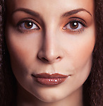 Closeup face beauty portrait of a woman with beautiful eyes in her early thirties