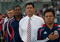 From l to r, Chivas coaches Carlos Juarez, headcoach Martin Vasquez, Carlos Llamosa and Daniel Gonzalez during the National Anthem of the  Chivas USA and the Columbus Crew game at the Home Depot Center in Carson, CA, on July 31, 2010. Chivas USA 3, Columbus Crew 1.