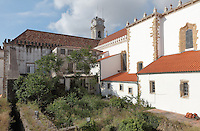 Coimbra University buildings seen from the first floor of the Joanina Library, or Biblioteca Joanina, a Baroque library built 1717-28 by Gaspar Ferreira, part of the University of Coimbra General Library, and a glimpse of the University clock tower, designed by Italian architect Antonio Canevari and built 1728-33, at the University of Coimbra in the former Palace of the Alcazaba, Coimbra, Portugal. The University of Coimbra was first founded in 1290 and moved to Coimbra in 1308 and to the royal palace in 1537. The buildings are listed as a historic monument and a UNESCO World Heritage Site. Picture by Manuel Cohen