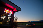 Dawn at the Agnew Grocery & Feed store, under a crescent moon.