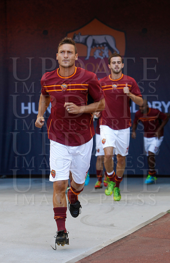 Calcio, Serie A: Roma vs Lazio. Roma, stadio Olimpico, 22 settembre 2013.<br /> AS Roma forward Francesco Totti, foreground, and midfielder Miralem Pjanic, of Bosnia, enter the pitch to warm up prior to the start of the Italian Serie A football match between AS Roma and Lazio, at Rome's Olympic stadium, 22 September 2013.<br /> UPDATE IMAGES PRESS/Isabella Bonotto