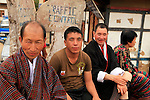 Asia, Bhutan, Wangdue. Three men sitting on corner in Wangdu Phodrang.