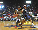 "Ole Miss guard Trevor Gaskins (23) drives and scores as East Tennessee State's Mike Smith (1) defends at the C.M. ""Tad"" Smith Coliseum in Oxford, Miss. on Saturday, December 18, 2010. Ole Miss won 71-50."