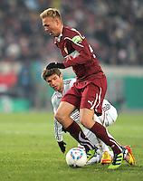 FUSSBALL   DFB POKAL   SAISON 2011/2012   VIERTELFINALE VfB Stuttgart - FC Bayern Muenchen                      08.02.2012 Thomas Mueller (li, FC Bayern Muenchen) gegen Raphael Holzhauser (VfB Stuttgart)