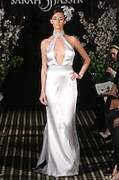 Model walks runway in a Passion wedding dress by Sarah Jassir, for the Sarah Jassir Fall 2011 - Desire bridal collection.