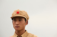 A competitor dressed in a PLA (People's Liberation Army) revolutionary era outfit participates in the Red Games. Held in Junan County, this sporting event is a nostalgic tribute to the communist era.