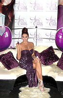 Amy Childs launches her debut fragrance - 'Amy Childs' with a photocall at Aura, St James, London, England..August 15th 2012.full length purple strapless sequins sequined dress legs crossed silver sandals shoes hair up legs crossed slit split .CAP/PP/CB.©Cliff Bass/PP/Capital Pictures.