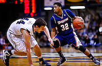 INDIANAPOLIS, IN - FEBRUARY 19: As Andrew Smith #44 of the Butler Bulldogs stumbles Sean Johnson #32 of the Duquesne Dukes dribbles the ball up court at Hinkle Fieldhouse on February 19, 2013 in Indianapolis, Indiana. Butler defeated Duquesne 68-49. (Photo by Michael Hickey/Getty Images) *** Local Caption *** Andrew Smith; Sean Johnson