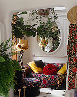 Shawls have been used to great decorative effect in the corner of this living room