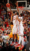 Ohio State Buckeyes forward Sam Thompson (12) blocks the shot of Wyoming Cowboys guard Josh Adams (14) beside teammate center Amir Williams (23) during the second half of the NCAA basketball game at Value City Arena in Columbus on Nov. 25, 2013. The Buckeyes won 65-50. (Adam Cairns / The Columbus Dispatch)
