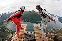 Andre bach (left, Norway) about to race Hans Lange (Norway) during World Base Race, the first event where BASE jumpers compete to be the fastest flying down from a mountain, before deploying their parachute. The the contestants jump from a mountain in the fjord Innfjorden in Western Norway, two jumpers race each other to the finish line 750 meters horizontally from the mountain.
