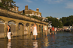 Richmond Upon Thames, Surrey, England 2007. High tide on the banks of the river Thames along the Thames Path. Old boat houses under St Helena Terrace.