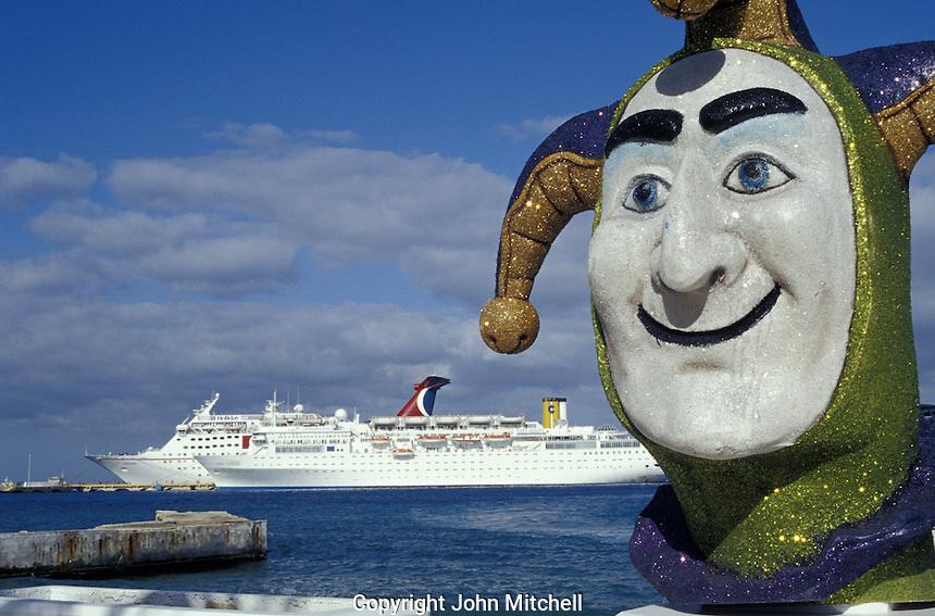 Jester scuplture with cruise ship in Background, Isla de Cozumel, Quintana Roo, Mexcio