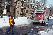 Snow removal crew blowing snow along a street in Montreal, quebec