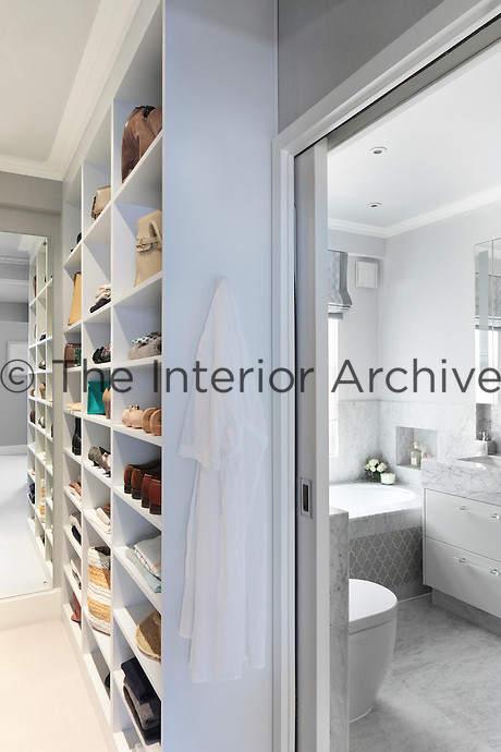 Built-in shelving outside one of the bathrooms creates a feature out of shoe and accessory storage