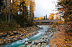 Whistler Creek footbridge connects the villages of Whistler and Blackcomb, British Columbia destination resorts.  In this fall 2009 photograph the villages are past the busy summer season and awaiting the 2010 Winter Olympic Games.
