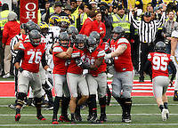 Ohio State Buckeyes place kicker Tyler Durbin (92) is congratulated by teammates after making a field goal to send the game to overtime during Saturday's NCAA Division I football game against the Michigan Wolverines at Ohio Stadium in Columbus on November 26, 2016. (Barbara J. Perenic/The Columbus Dispatch)
