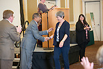 Tery Swank, Assitant Director, Child Development Center, is congratulated by President McDavis for her 30 years of service at the  2016 Outstanding Administrator Award ceremony.