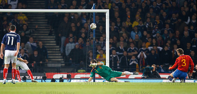 Gerard Pique heads in off the underside of the bar to score an own goal and equalise for Scotland as keeper Iker Casillas is beaten