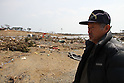 "March 29, 2011, Minamisanriku, Miyagi, Japan - More than two weeks after the tsunami the rural area between Kesennuma and Minamisanriku lies in ruin. Terao Saito, 62, looks across the wreckage at where his factory used to be. ""The JSDF troops are working really hard. I know they are."" (Photo by Wesley Cheek/AFLO) [3682]."