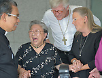 Koko Kondo (second from left), a survivor of the 1945 atom bombing of Hiroshima, Japan, laughs as she talks with Bishop Mary Ann Swenson (right) and other church leaders on August 7 in Hiroshima. Swenson, a United Methodist from the U.S., is vice moderator of the World Council of Churches Central Committee, and is leading a delegation of church leaders from around the world who have come to see for themselves the suffering caused by the bomb, to listen to the survivors and to local church leaders, and to return home recommitted to advocating for an end to nuclear weapons. Kondo is a well-known hibakusha, or atom bomb survivor, who along with her father is mentioned in John Hershey's landmark book about the horror of Hiroshima.