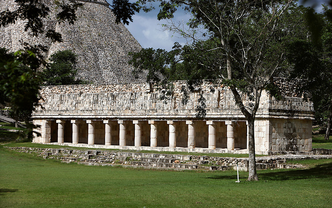 Vestuary of the Ball Court with the Temple of the Magician in the distance, Puuc architecture, Uxmal late classical Mayan site, flourished between 600-900 AD, Yucatan, Mexico. Picture by Manuel Cohen