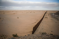 The fence marking the border between the United States and Mexico is seen from the Mexican side in the Sonoran Desert of Arizona on Sunday, Feb. 3, 2008.