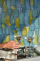 Bottles, a jewel glass mosaic in  Peridot, Serpentine, and Mica, is part of the Erin Adams Collection for New Ravenna Mosaics.<br />