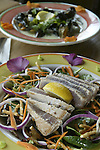 Ahi tuna salad and mussels cooked in cream sauce cooked by Barking Dog Alehouse chef Zeth Nelson.. Jim Bryant Photo