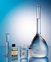 VOLUME ESTIMATING &amp; SOLVING: ACCULUTE VIAL<br /> An acculute vial holds more than a 10ml graduate and less than a 100ml beaker. Therefore it's volume lies somewhere in-between.  When the vial is diluted with water to make one liter it produces a solution that is 0.10M HCl.