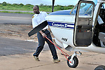 Rukang Chikomb, a pilot with the Wings of the Morning aviation ministry of The United Methodist Church, with a plane in the program's hanger in Lubumbashi, Democratic Republic of the Congo.