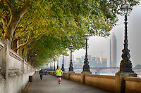 UK, England, London.  Early Morning Walkers and Joggers along the Jubilee Greenway, South Bank, Thames River.