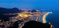 Rio de Janeiro south zone at night, located between the Tijuca Massif, the Atlantic Ocean and Guanabara Bay. In this region, the majority of the city's famous balneario beaches ( like Ipanema and Leblon at right )  are located, as well as the Lagoa Rodrigo de Freitas and Jockey Club do Brasil ( in the center ), much of the Tijuca National Park ( at left ), the Sugar Loaf hill, the Corcovado hill, where the famous statue of Christ the Redeemer stands, and other natural wonders and tourist attractions. It is the richest region of the city, and is visited by thousands of tourists from different parts of the world throughout the year.