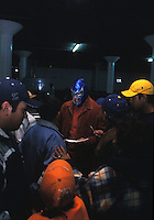 El Hijo del Blue Demon, surounded by fans,  arriving at the parking lot of La Arena Mexico, the stadium where he is about to fight.